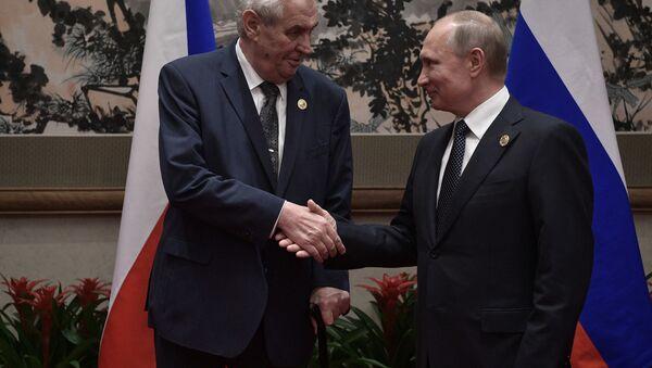 Miloš Zeman a Vladimir Putin během schůzky v Číně. - Sputnik Česká republika