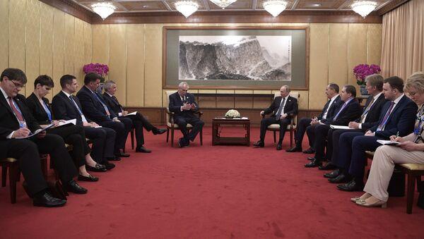 Český prezident Miloš Zeman a ruský prezident Vladimir Putin během schůzky v Číně - Sputnik Česká republika