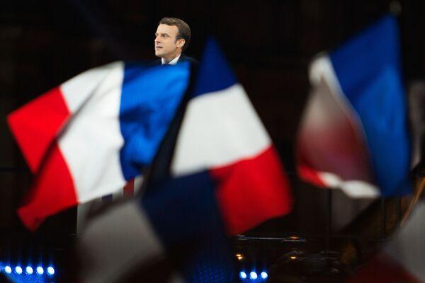 Vůdce hnutí En Marche Emmanuel Macron, vítěz francouzských prezidentských voleb, během svého vítězného projevu před pařížským Louvrem - Sputnik Česká republika