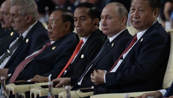 Ruský prezident Vladimir Putin a zástupce Čínské lidové republiky Si Ťin-pching - Sputnik Česká republika