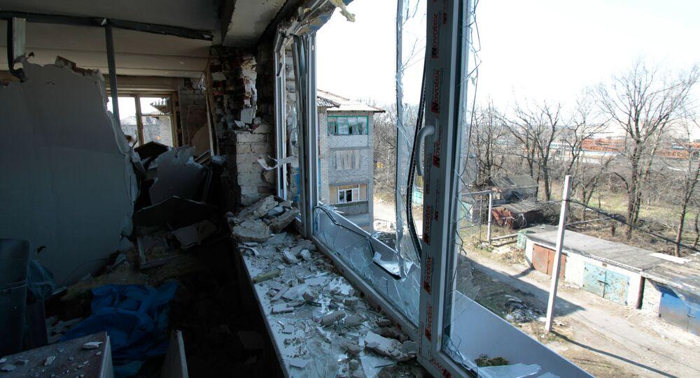 Následky ostřelování v obci Doněck-Severnyj v Doněcké oblasti