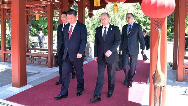 Vladimir Putin a Si Ťin-pching na fóru Jeden pás - jedna cesta - Sputnik Česká republika