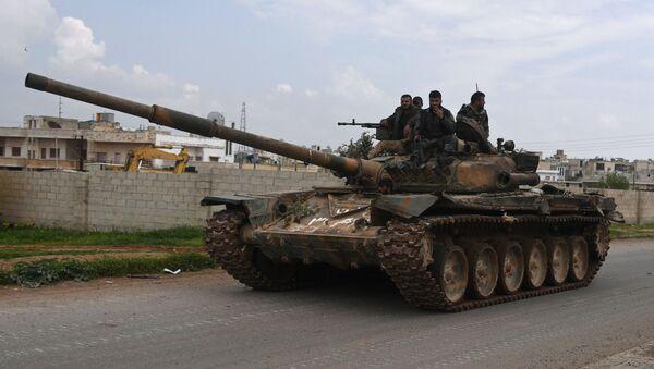 Syrští vojáci na tanku. Archivní foto - Sputnik Česká republika