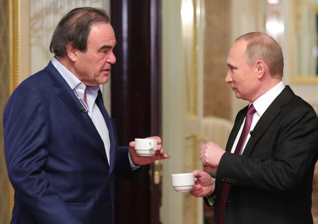 Prezident RF Vladimir Putin a režisér Oliver Stone. Ilustrační foto