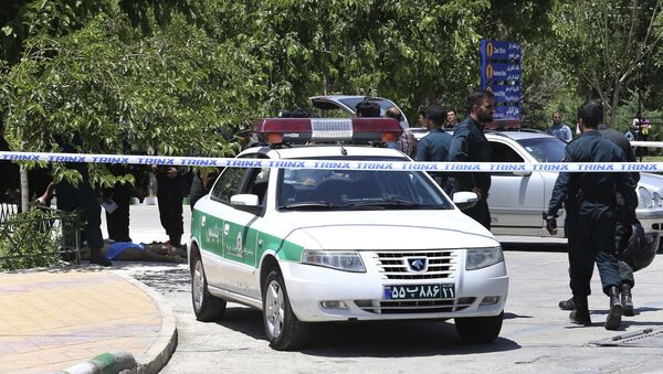 Policie na místě útoku na íránský parlament - Sputnik Česká republika