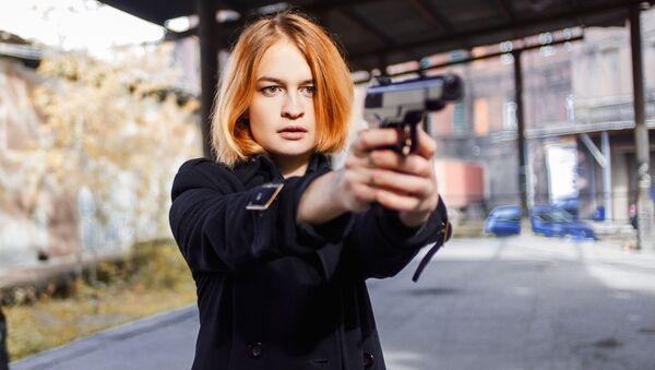 Dívka s pistolí - Sputnik Česká republika