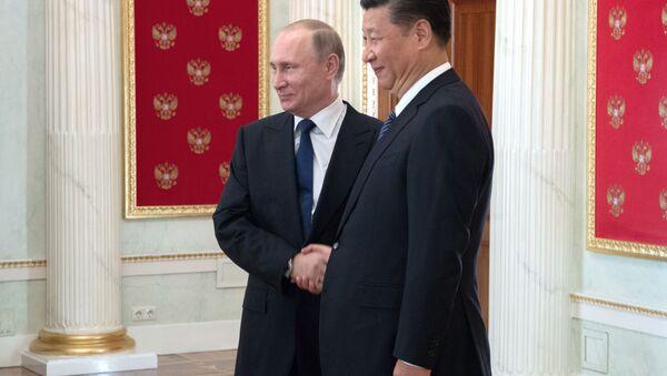 Prezident Ruska Vladimír Putin a čínský prezident Si Ťin-ping - Sputnik Česká republika