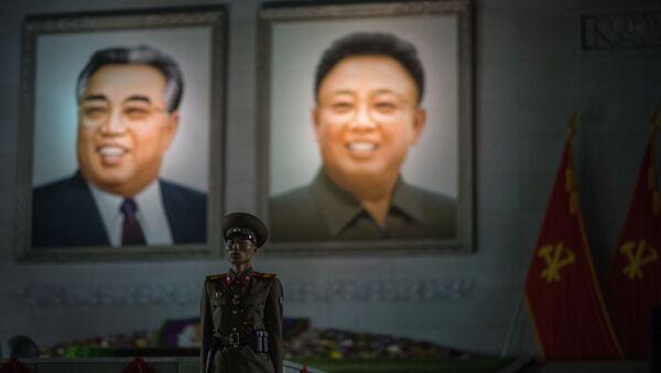 Portréty Kim Kim Čong-il a Kim Ir-sen - Sputnik Česká republika