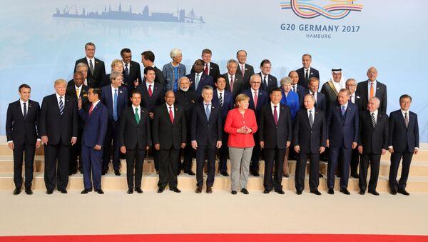 Společné fotografování účastníků G20 v Hamburku - Sputnik Česká republika