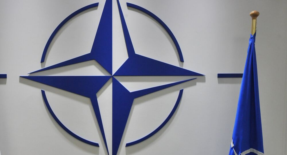 French flag and NATO flag are pictured at NATO headquarters on September 3, 2012 at the NATO headquarters in Brussels.
