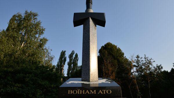 Památník padlým ukrajinským vojákům na Donbasu - Sputnik Česká republika