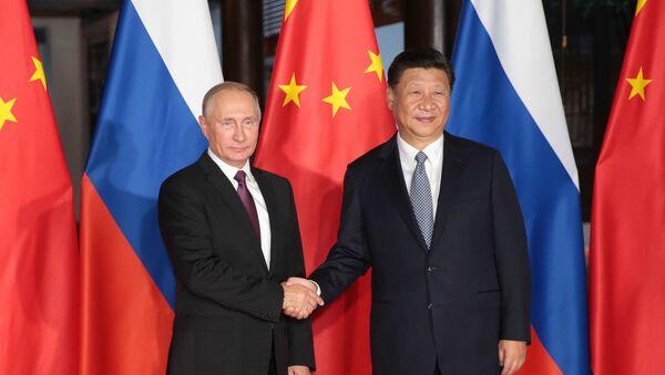 Ruský prezident Vladimir Putin a prezident ČLR Si Ťin-pching - Sputnik Česká republika