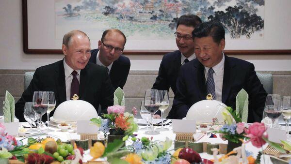 Ruský prezident Vladimir Putin a čínská hlava státu Si Ťin-pching. Ilustrační foto - Sputnik Česká republika