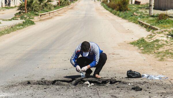 Sběr půdy po chemickém útoku v Sýrii. Ilustrační foto - Sputnik Česká republika