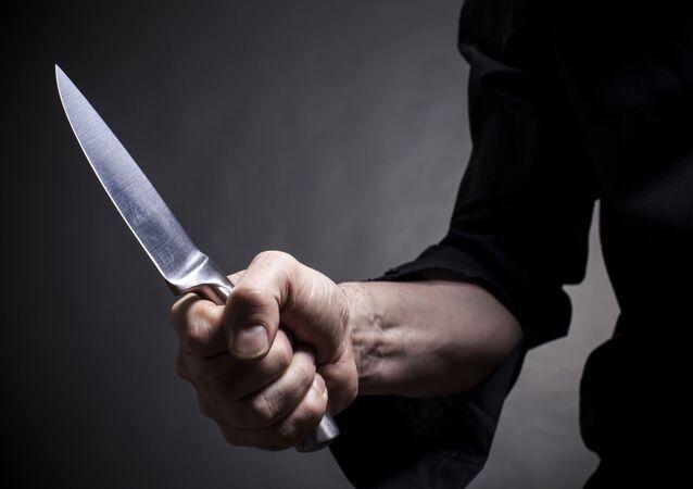 Muž s nožem