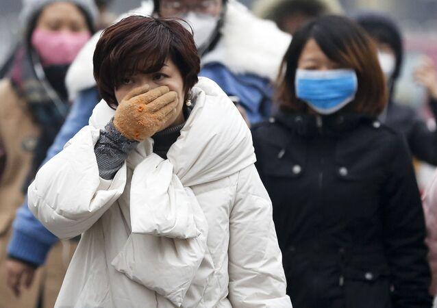 Číňané v maskách