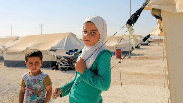Děti v uprchlickém táboru severně od Rakky - Sputnik Česká republika