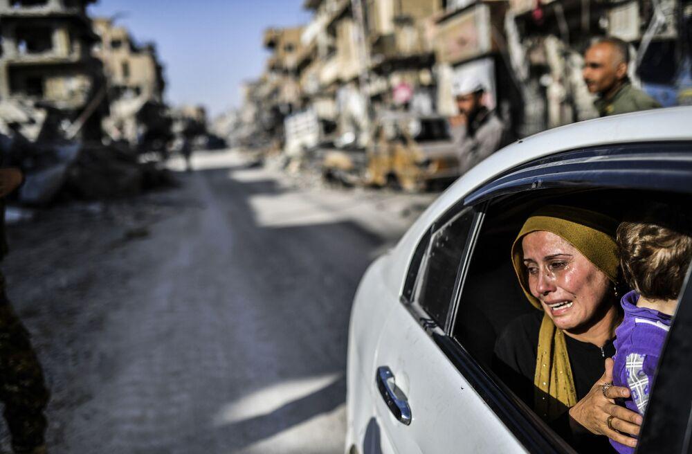 Žena po návratu do syrské Rakky