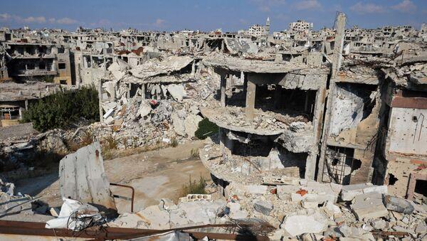 Trosky v syrském městě Homs. Ilustrační foto. - Sputnik Česká republika