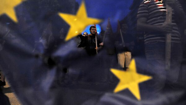 Protestující Řekové na pochodu proti EU v Soluni. - Sputnik Česká republika
