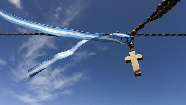 Kříž s argentinskou vlajkou - Sputnik Česká republika
