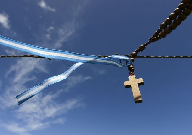 Kříž s argentinskou vlajkou