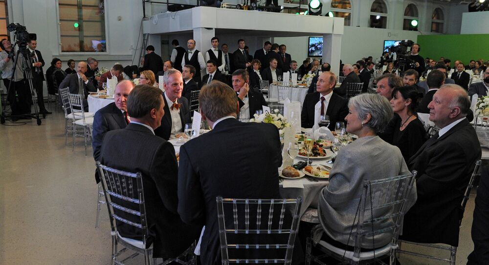 Prezident Putin na jubileu televizni stanice RT vedle Flynna