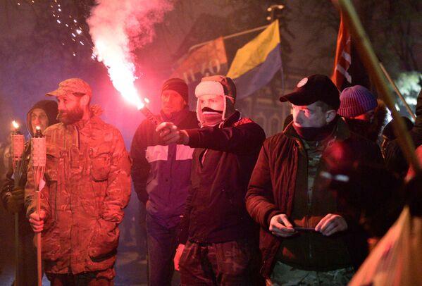 Účastníci pochodu v Kyjevě u příležitosti výročí zahájení událostí na Majdanu - Sputnik Česká republika