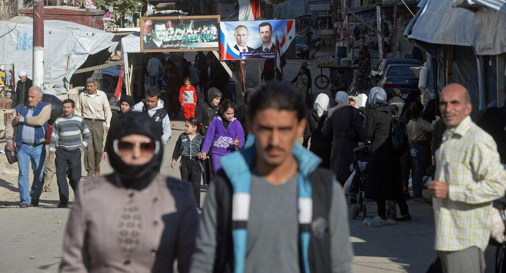 Aleppo, Sýrie. Portréty s Asadem a Putinem