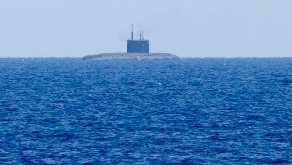 Ruská ponorka během odpálení Kalibrů - Sputnik Česká republika