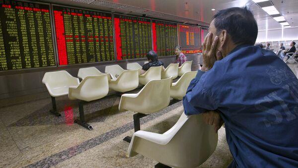 Čínští investoři na burze v Pekingu - Sputnik Česká republika