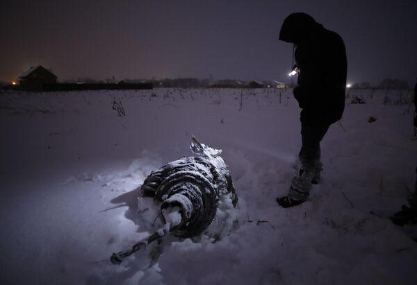 První snímky z místa pádu An-148 u Moskvy a situace na letišti Domodědovo - Sputnik Česká republika