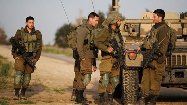 Izraelští vojáci na hranici s Pásmem Gazy - Sputnik Česká republika
