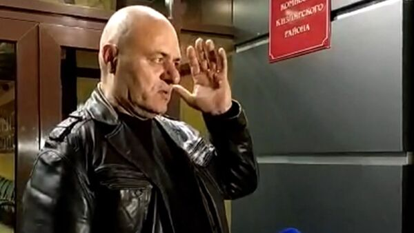 Bezpečnostní kamery zachytily střelce, který střílel v dagestánském Kizljaru - Sputnik Česká republika