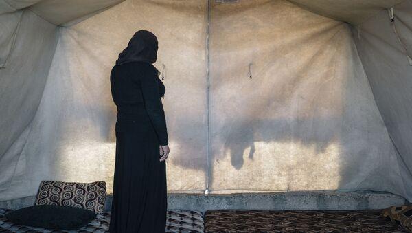 Jezídská žena v uprchlickém táboře v Iráku - Sputnik Česká republika