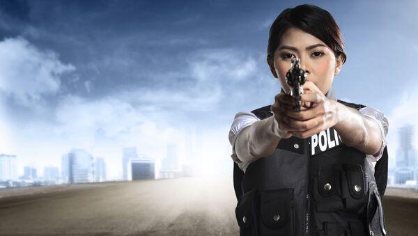 Hezká dívka v policejní uniformě - Sputnik Česká republika