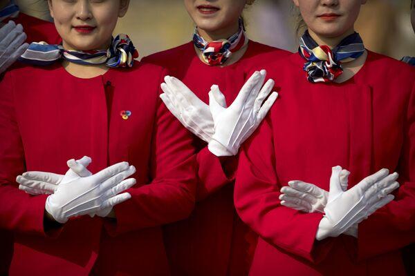 Nejkrásnější hostesky během Všečínského shromáždění národních představitelů v Pekingu - Sputnik Česká republika