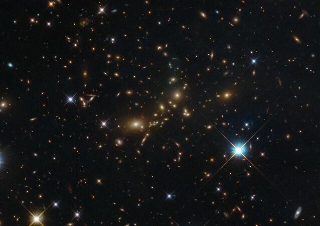 Seskupení galaxií PLCK G308.3-20.2 v souhvězdí Rajky
