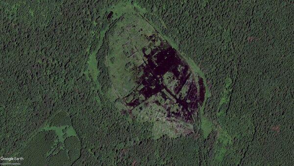 Uralský badatel oznámil, že nalezl v bažině mýtický staroruský hrad Kitěž - Sputnik Česká republika