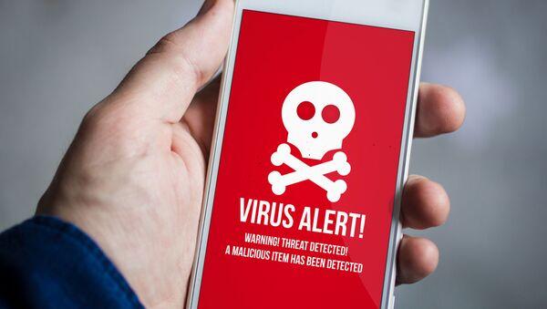 Varování o škodlivém softwaru na chytrém telefonu. Ilustrační foto - Sputnik Česká republika