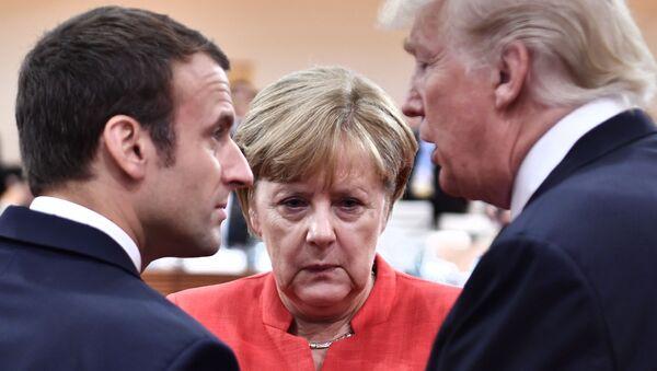 Francouzský prezident Emmanuel Macron, německá kancléřka Angela Merkelová a prezident USA Donald Trump - Sputnik Česká republika