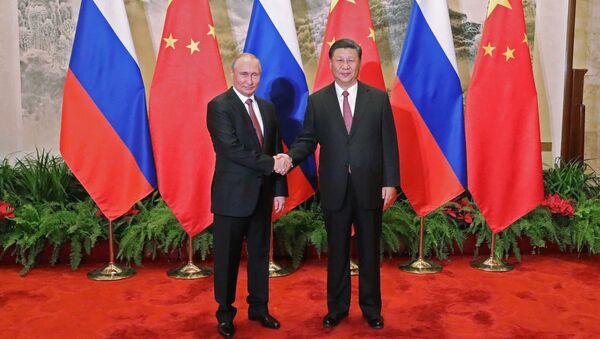 Ruský prezident Vladimir Putin a jeho čínský protějšek Si Ťin-pching - Sputnik Česká republika