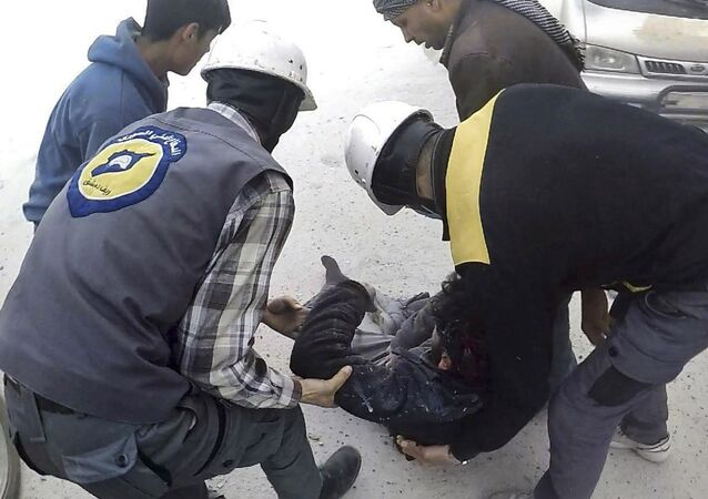 This photo provided by the Syrian Civil Defense White Helmets, which has been authenticated based on its contents and other AP reporting, shows members of the Syrian Civil Defense group helping a wounded man after airstrikes hit Ghouta, a suburb of Damascus, Syria, Thursday, March. 1, 2018
