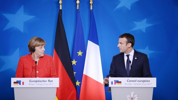 Kancléřka SRN Angela Merkelová a francouzský prezident Emmanuel Macron - Sputnik Česká republika
