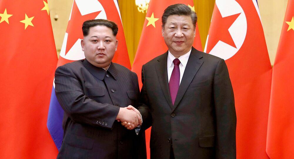 Vůdce KLDR Kim Čong-un a čínský prezident Si Ťin-pching. Ilustrační foto