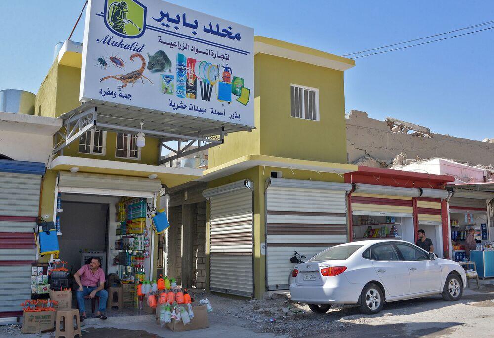 Prodejci v Mosulu, osvobozeném vládními jednotkami. Červenec 2018