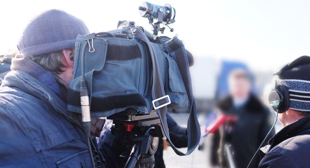 Kameraman za prací