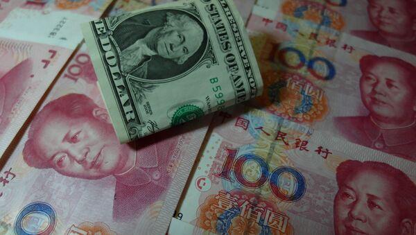 Jüany a dolar - Sputnik Česká republika