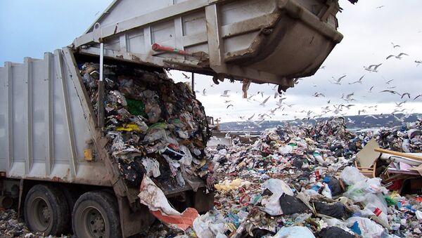 Odpadní kamion v USA - Sputnik Česká republika