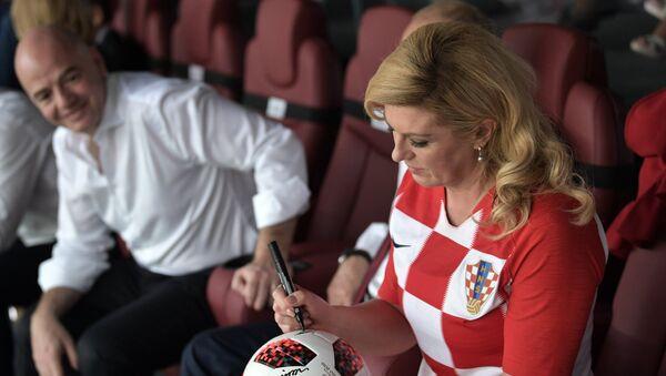 Chorvatská prezidentka Kolinda Grabarová Kitarovićová a prezident FIFA Gianni Infantino - Sputnik Česká republika